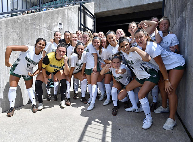 The Loyola Women's Soccer team poses for a group photo