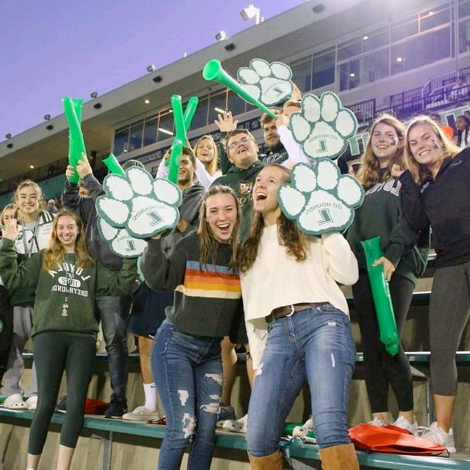 Students cheering in a crowd at a Loyola soccer game
