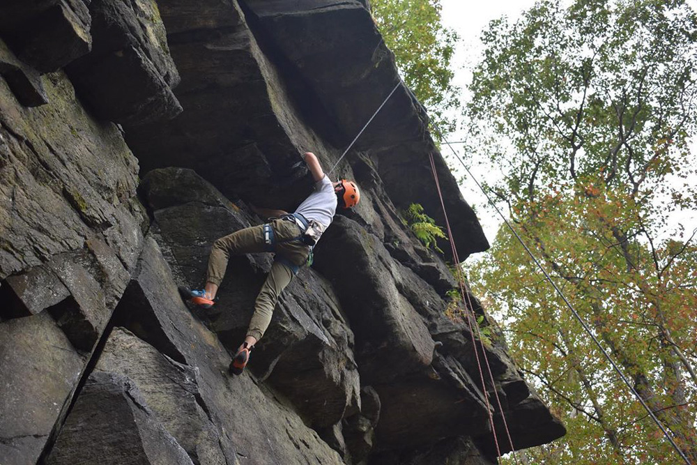 Student from the Outdoor Adventure Experience club rock climbing