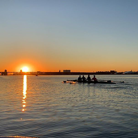 Members of the Loyola Women's Rowing team on the water.
