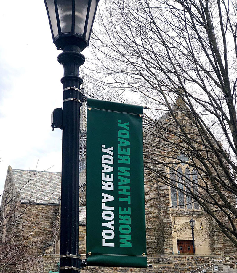 Banner on campus reading