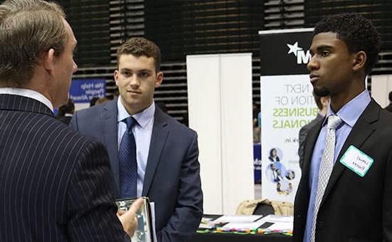 Two students at a career fair